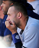 New York Yankees designated hitter Derek Jeter (2) watches eighth inning action from the dugout against the Baltimore Orioles at Oriole Park at Camden Yards in Baltimore, Maryland in the first game of a doubleheader on Sunday, August 28, 2011.  The Orioles won the game 2 - 0..Credit: Ron Sachs / CNP.(RESTRICTION: NO New York or New Jersey Newspapers or newspapers within a 75 mile radius of New York City)