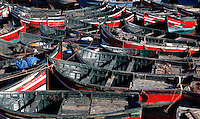 Traditional wooden  fishing boats mooring together in the harbour, El Jadida, Morocco. El Jadida, previously known as Mazagan (Portuguese: Mazag√£o), was seized in 1502 by the Portuguese, and they controlled this city until 1769. Picture by Manuel Cohen