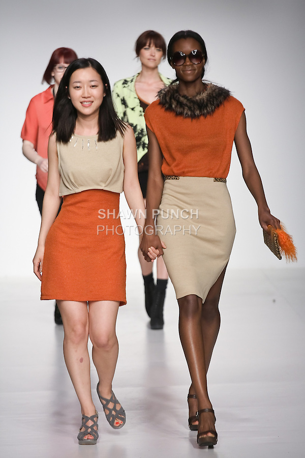 Senior fashion designer Ji Hye Wang, walks runway with model, at the close of the Pratt 2011 fashion show.