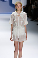 Janice Alida walks runway in a White textured gauze drawstring coat with oversized hood, by Vera Wang, for the Vera Wang Spring 2012 collection, during Mercedes-Benz Fashion Week Spring 2012.