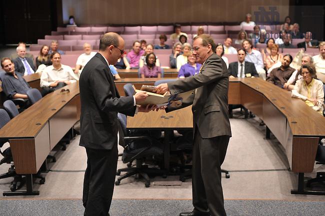 James J. McKenna receives the 2008 Sheedy award from Dean John McGreevy...Photo by Matt Cashore/University of Notre Dame