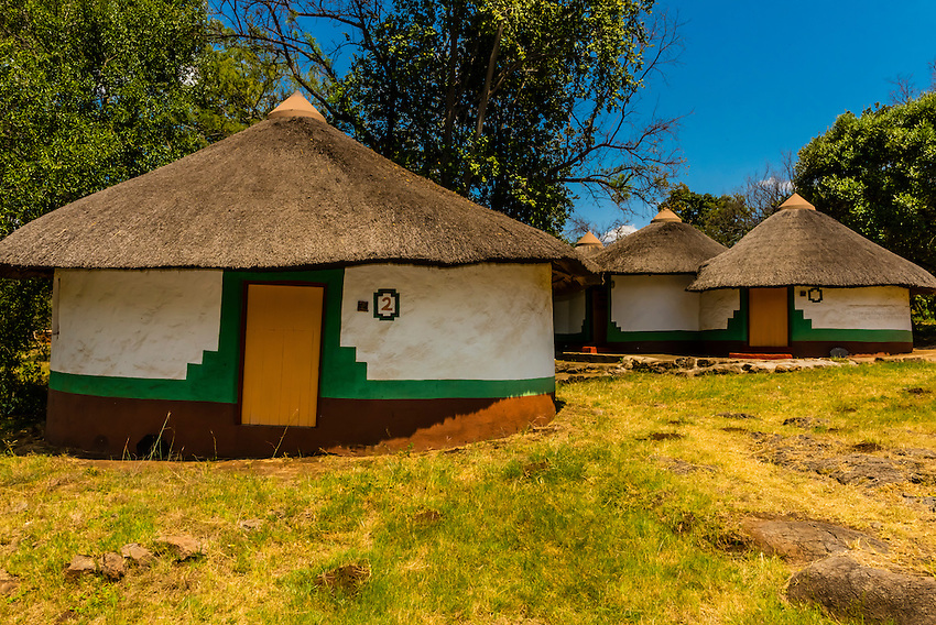 Lesedi Cultural Village, Broederstroom (near Johannesburg), South Africa. The cultural village includes five traditional homesteads, each inhabited by Zulu, Xhosa, Pedi, Basotho and Ndebele tribes who live according to tribal folklore and traditions of their ancestors.