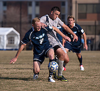 Brandon Allen (10) of Georgetown fights for the wall with Julian Ringhof (33) of San Diego during the game at North Kehoe Field in Washington, DC.  Georgetown defeated San Diego, 3-1.