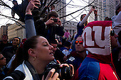 New York, New York<br /> February 7, 2012<br /> <br /> Crowds watch the New York Giants victory Super Bowl parade, after defeating the  New England Patriots, as it moves down Lafayette Street  at Foley Square. Quarterback Eli Manning holds up the Vince Lombardi Trophy as his float passes by.