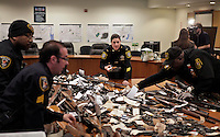 New Jersey, United States. 19th Feb, 2013. Police members organize weapons displayed to the media after being acquired during the Gun Buyback program, last weekend, in the Essex county in New Jersey. Photo by Kena Betancur / VIEWpress.