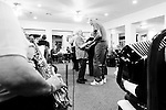 CHAD PILSTER &bull;&nbsp;Hays Daily News<br /> <br /> LaVerna Herl, left, a resident, Bob Gottschalk, an employee, dance as Rosie Dinkel plays the saxophone and Norma Weimer plays the accordion on Thursday, October 17, 2013 as polka music is played by the Wes Windholz Band at the Cedar View Assisted Living Residence in Hays, Kansas. The Wes Windholz Band plays the third Thursday of every month at area retirement homes.