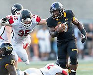 Baltimore, MD - SEPT 10, 2016: Towson Tigers running back Darius Victor (7) eludes the tackel of St. Francis (Pa) Red Flash linebacker Zane Stewart (35) during game at Johnny Unitas Stadium in Baltimore, MD. The Tigers defeated St. Francis 35-28. (Photo by Phil Peters/Media Images International)