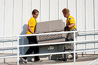 National Disaster Animal Response Team members Wendy Leonard (left) and Pam Siegler carry a dog into a temporary shelter set up at the Columbia, SC airport after a raid on a puppy mill in Johnston, SC on Tuesday, Sept. 11, 2012. HSUS workers found over 200 dogs, nine horses and 30-40 fowl. (Leonard: 478-987-4679 / Siegler 931-438-8987)