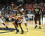 Mississippi State's Dee Bost (3) vs. Ole Miss' Nick Williams (20) at the C.M. &quot;Tad&quot; Smith Coliseum in Oxford, Miss. on Wednesday, January 18, 2012. (AP Photo/Oxford Eagle, Bruce Newman).