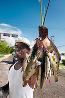 Belize City, Belize, April 2012. Street vendors sell Snoek fish on the main streat just outside Belize city in an empoverished area. Photo by Frits Meyst/Adventure4ever.com