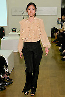 85 Broads member walks runway in an FW10 french lace tiered blouse  and FW silk black faile pants by Yuna Yang, during the 85 Broads Presents Yuna Yang trunk show at Art Gate Gallery on October 24th 2011.
