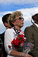 WASHINGTON DC - SEPTEMBER 11: As guest on the front row of a 9 11 Pentagon ceremony listens as United States President Barack Obama delivers remarks at the Pentagon Memorial in Washington, DC during an observance ceremony to commemorate the 15th anniversary of the 9/11 terrorist attacks, Sunday, September 11, 2016. <br /> Credit: Dennis Brack / Pool via CNP/MediaPunch