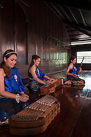 Traditional female Thai Musician at and old traditional House in Phra Nakhon Si Ayutthaya