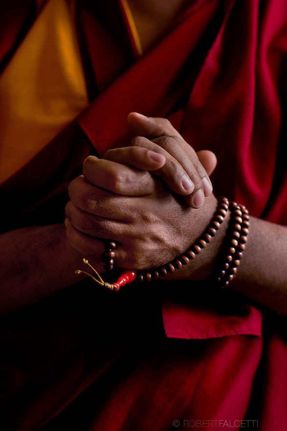 WATERTOWN, CT- FEBRUARY 29, 2009: The Mala beads worn by Geshe Lozang Samdup who was born in Nubra Chakrasa, Ladakh in the north of India in the year 1962. He was then called Samdup Wangdue. At the age of 13, he joined the Buddhist Order in Nubra Dekit Monastery under the abbotship of Ven. Lobzang Tsephel, from whom he received his preliminary and novice vows. He was given the novice name Lobzang Samdup. He passed through the monastic trainings, memorizing the scriptures successfully. In the 1980, having joined Drepung Gomang Monastic University, he started his formal studies in Buddhist philosophy under the tutorship of the former abbot of the Monastery, The most Venerable Khensur Lobsang Tenpa. He studied all the five major scriptural texts that the Monastic University offers; Logic and Syllogism, Perfection of Wisdom, the Middle Way view, Abhidharmakosh and Vinaya Ethics. In 1982, during His Holiness the Dalai Lama's visit to Ganden Monastic University, which was founded by Lama Tsongkhapa, he received his full ordination vows from His Holiness.   (Photo by Robert Falcetti). .
