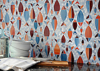 Floating Fish, a water jet jewel glass mosaic shown in Mica, Sardonyx, Garnet, Pearl, and Quartz, is part of the Erin Adams Collection for New Ravenna Mosaics.<br />