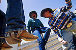 11 MAY 2002 - BUCKEYE, ARIZONA, USA: Paul Brashears, right, stretches behind the chutes at the Arizona West PRCA Rodeo in Buckeye, AZ, May 11, 2002. It was the first year for the Arizona West PRCA Rodeo..PHOTO BY JACK KURTZ