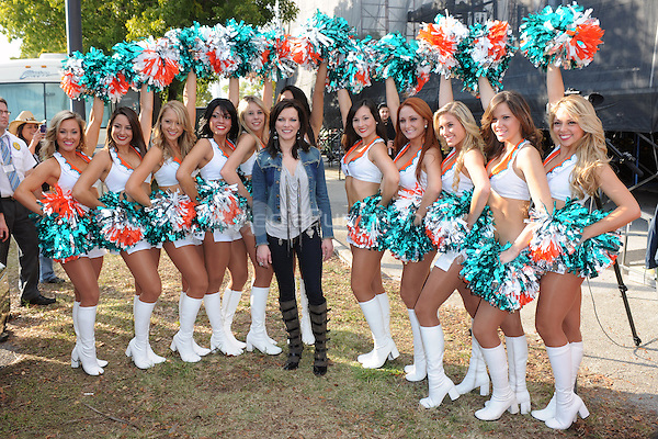 Martina McBride poses with the Miami Dolphons Cheerleaders backstage at the 99.9 Kiss Country Chili Cookoff concert held at C.B. Smith park on January 30, 2011 in Pembroke Pines Florida. © MediaPunch Inc. / MPI04