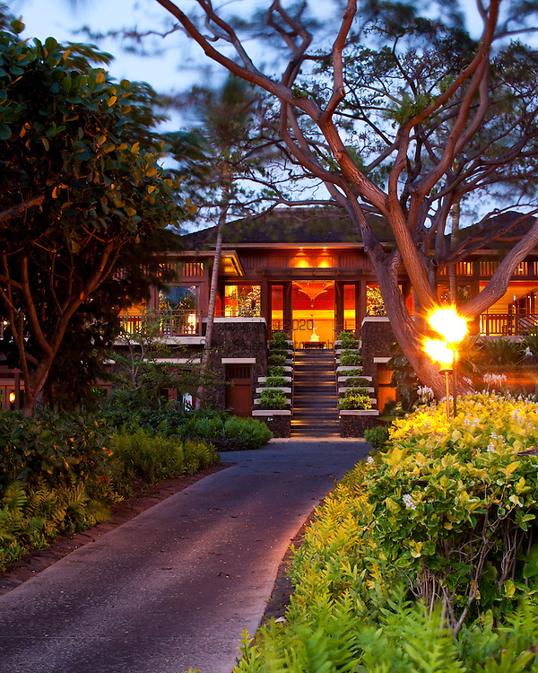 The Four Seasons Resort Hualalai at Historic Kaupulehu on the Big Island of Hawaii. The main lobby building at dusk and sunrise.