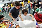 Medford and Somerville children do a crafting activity in Gantcher Center on Kids Day at Tufts University. (Matthew Modoono for Tufts University)
