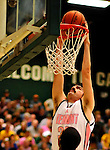 13 February 2011: University of Vermont Catamount forward Evan Fjeld, a Senior from Durham, NC, in action against the Binghamton University Bearcats at Patrick Gymnasium in Burlington, Vermont. The Catamounts came from behind to defeat the Bearcats 60-51 in their America East matchup. The Cats took part in the National Pink Zone Breast Cancer Awareness Program by wearing special white jerseys with pink trim. The jerseys were auctioned off following the game with proceeds going to the Vermont Cancer Center. Mandatory Credit: Ed Wolfstein Photo
