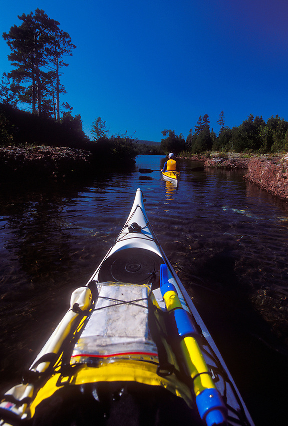 Sea kayakers paddle through a narrow outlet between Agate Harbor and Lake Superior on the Keweenaw Peninsula near Copper Harbor, Mich.