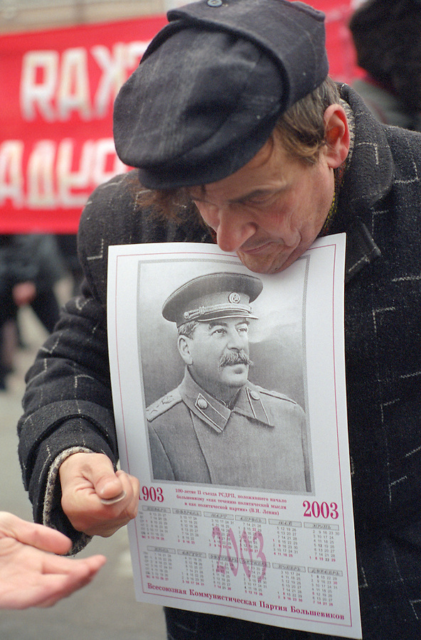 Saint Petersburg, Russia, 07/11/2002..Cradle of the revolution - Communist supporters march and demonstrate in the city centre to mark the 85th anniversary of the Bolshevik revolution of October 1917. A Communist supporter sells calendars with Stalin?s portrait.