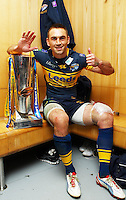 PICTURE BY VAUGHN RIDLEY/SWPIX.COM - Rugby League - Super League Grand Final 2012 - Warrington Wolves v Leeds Rhinos - Old Trafford, Manchester, England - 06/10/12 - Leeds Captain Kevin Sinfield with the Grand Final Trophy, winning his 6th title.