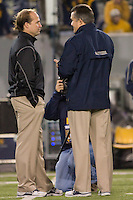 WVU head coach Dana Holgorsen and Pitt head coach Todd Graham chat before the game. The WVU Mountaineers beat the Pitt Panthers 21-20 at Mountaineer Field in Morgantown, West Virginia on November 25, 2011.