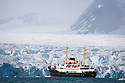 Cruise ship in front of large glacier, June, Svalbard, Norway