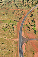Jan 15, 2009 - Alice Springs, Northern Territory, Australia - Aerial images of the outback in central Australia over Henbury Cattle Station.  Henbury station which spans over 6,000 square miles is about 130km from the outback town of Alice Springs. After recent rains the outback looks alive with patches of green. Here the Stuart Highway cuts through the outback as a road train travels along..(Credit Image: © Hannah Mason/Corbis)