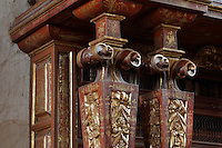 Detail of the scrolled columns of the bookcases with Chinese motifs, lacquer and gilding by Manuel da Silva, in the Red Room of the Joanina Library, or Biblioteca Joanina, a Baroque library built 1717-28 by Gaspar Ferreira, part of the University of Coimbra General Library, in Coimbra, Portugal. The Casa da Livraria was built during the reign of King John V or Joao V, and consists of the Green Room, Red Room and Black Room, with 250,000 books dating from the 16th - 18th centuries. The library is part of the Faculty of Law and the University is housed in the buildings of the Royal Palace of Coimbra. The building is classified as a national monument and UNESCO World Heritage Site. Picture by Manuel Cohen