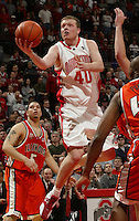 (3/6/05) Ohio State's Matt Sylvester splits the Illinois defense for a lay-up in the second half. (Photos for the Dispatch by Will Shilling)
