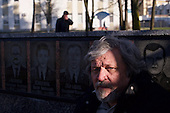 &quot;Liquidator&quot; Alexander Demidov, 61, sits in front of a commemoration of the heroes that perished during the Chernobyl explosion in 1986. He was part of a massive team responsible for the clean up of the nuclear fallout in the months and years that followed. <br /> <br /> He is posing in the main town square of Slavutych, his home for the last decades. He is suffering from multiple health problems in his lungs and joints. <br /> <br /> Slavutych rises out of the ashes of the Chernobyl nuclear disaster in April 26, 1986. People living near the disaster area were largely moved to the new city, built from scratch for the sole purpose of housing the population displaced by the nuclear accident.