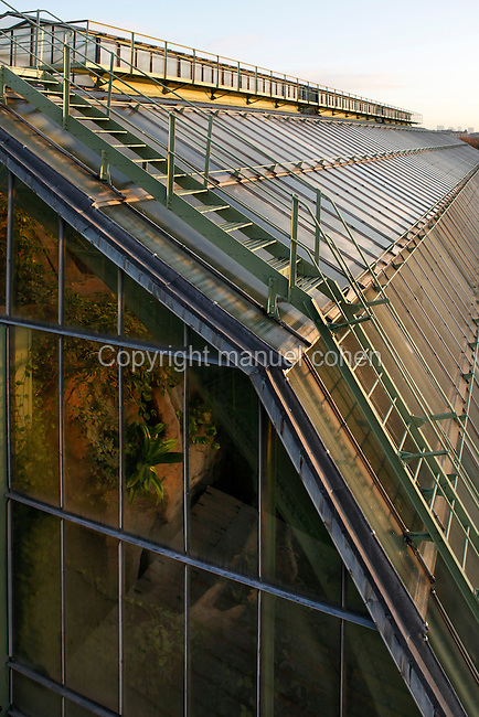 Tropical Rainforest Glasshouse (formerly Le Jardin d'Hiver), 1936, René Berger, Jardin des Plantes, Museum National d'Histoire Naturelle, Paris, France. Long side view of the roof's metallic structure. Through the front windows the luxuriant vegetation, lit by the winter early morning light, may be seen.