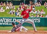 21 March 2015: Washington infielder Emmanuel Burriss gets a force out at second in the 4th inning of a Spring Training Split Squad game against the Atlanta Braves at Champion Stadium at the ESPN Wide World of Sports Complex in Kissimmee, Florida. The Braves defeated the Nationals 5-2 in Grapefruit League play. Mandatory Credit: Ed Wolfstein Photo *** RAW (NEF) Image File Available ***
