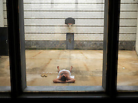 An inmate sunbathes in the courtyard in Putnam County Jail.