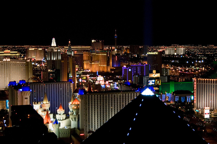 Nevada, NV, Las Vegas, city at night, nightscape, aerial, Las Vegas Strip from Mix Club at Mandalay Bay Hotel, Pyramid of the Luxor Hotel in the foreground, Photo nv256-18716. .Copyright: Lee Foster, www.fostertravel.com, 510-549-2202,lee@fostertravel.com