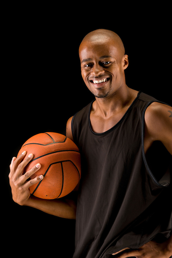 Young african american basketball player smiling.