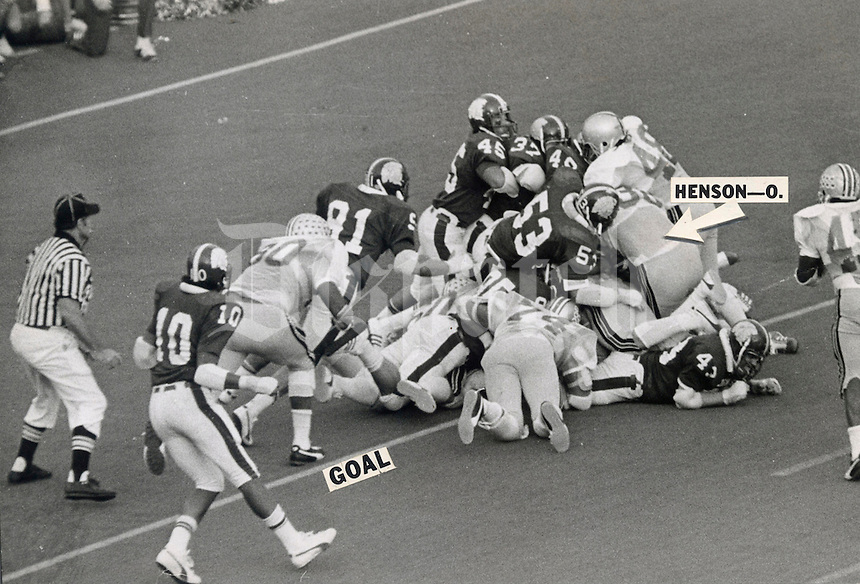 """Black and white file photo - OSU-MICHIGAN STATE GAME 1974 - November 9, 1974  TD, OR NO? -- Officials ruled that Ohio State fullback Champ Henson (38) failed to break the plane of the goal line on this plunge over right tackle in the final seconds of Saturday's game at Michigan State. Time ran out before another play, giving Michigan State a 16-13 upset victory. Judge for yourself in this Dispatch photo whether you agree with Henson that """"I was over the goal line.""""   (Columbus Dispatch photo)"""