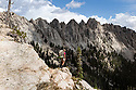 ID00621-00...IDAHO - Hiker exploring off trail along Sawtooth lake Trail, Sawtooth Wilderness - Sawtooth National Recreation Area.