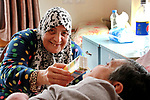 An elderly Palestinian woman help her friend at El Wafa elderly nursing home, in Gaza city on Feb. 12, 2017. El Wafa elderly nursing home was established in 1980 as one of programs of Al-Wafa charity association. El-Wafa hospital was destroy during the 50-day war between Israel and Hamas militants in the summer of 2014 by Israeli forces. Photo by Sana'a Al-Ajez