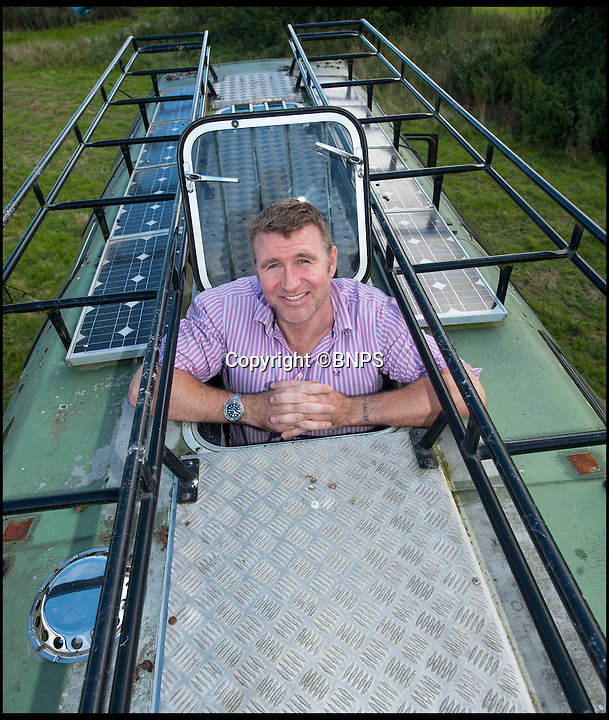 BNPS.co.uk (01202 558833)<br /> Pic: PhilYeomans/BNPS<br /> <br /> Solar panels on the roof provide the electricity.<br /> <br /> Carry on campski...<br /> <br /> Madcap Chris Armstrong has turned a Cold War Russian army monster truck into the ultimate camper van.<br /> <br /> Chris, 41, has converted the back of the 12.5 ton six wheel drive into luxury accommodation that has a double bed, shower, toilet and its own kitchen with fridge.<br /> <br /> He turns heads whenever he roars onto a countryside campsite in the beast and has actually been banned from several parks because of the sheer size of his communist camper. <br /> <br /> He is now selling it on eBay with a reserve price of &pound;21,000.