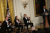 Us President Barack Obama jokes with the band members of the group Eagles (L-R) Don Henley, Timothy B. Schmit, Joe Walsh, 2016 Kennedy Center Honorees, in the East Room of the White House, December 4, 2016. The honorees include pianist Martha Argerich, actor Al Pacino, singer Mavis Staples, singer James Taylor and Eagles band members Don Henley, Timothy B. Schmit, Joe Walsh. <br /> Credit: Aude Guerrucci / Pool via CNP