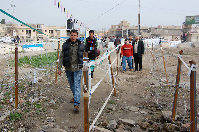 MOSUL, IRAQ: Voters walk into a polling station in Mosul...On March 7th, 2010, Iraq held nationwide parliamentary elections.