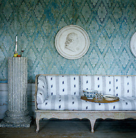 The French Directoire wallpaper pattern reflects neoclassical influences from the early 19th century