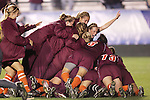 07 November 2008: Virginia Tech celebrates advancing in a penalty kick shootout. The University of Virginia and Virginia Tech played to a 1-1 tie after 2 overtimes at WakeMed Stadium at WakeMed Soccer Park in Cary, NC in a women's ACC tournament semifinal game.  Virginia Tech advanced to the final on penalty kicks, 2-1.