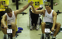 &copy; Peter Spurrier/Sports Photo +44 (0) 7973 819 551.PPP Healthcare British Indoor Rowing Championships.18th Nov. 2001.National Indoor Arena..Matthew Pinsent (L) joins hand with his rowing partner James Craacknell, after he won [Pinsent] the British Indoor Rowing Championships at Birmingham in the final few sscc's of the race... ........... [Mandatory Credit: Peter SPURRIER/Intersport Images]<br />