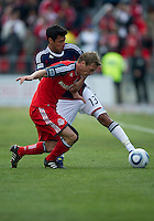 02 April 2011: Chivas USA defender Ante Jazic #13 and Toronto FC defender Ty Harden #20 in action during an MLS game between Chivas USA and the Toronto FC at BMO Field in Toronto, Ontario Canada..The game ended in a 1-1 draw...