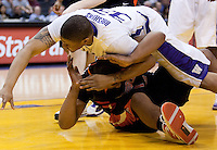 Tyreese Breshers (33) gets tangled up with Joe Burton. The Washington Huskies defeated the Oregon State Beavers 59-52 during the Pac-10 Tournament at the Staples Center in Los Angeles, California on March 11th, 2010.