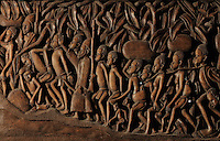 Wooden bas-relief and openwork sculpture of a procession of African slaves with Arab slave traders, by M Ulika Valentim, 1975, in the Musee d'Aquitaine, Cours Pasteur, Bordeaux, Aquitaine, France. The slaves are bound by the neck and carry heavy loads, accompanied by their children and an armed guard. Picture by Manuel Cohen